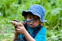 boy-playing-stick-like-gun-5313497